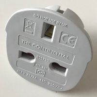 front view of generic adapter to use plugs type G from Zimbabwe in outlets type E from Monaco
